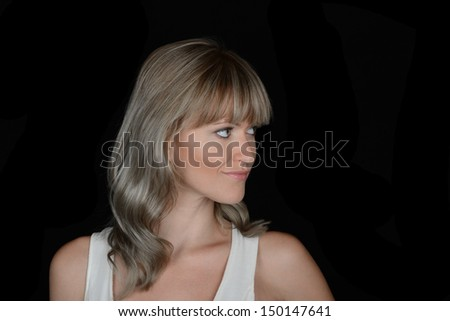 Beautiful Image of a Glamour model On Black Looking for your Product - stock photo