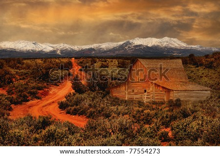 Beautiful image of a rural farmhouse with snow on Mountains - stock photo