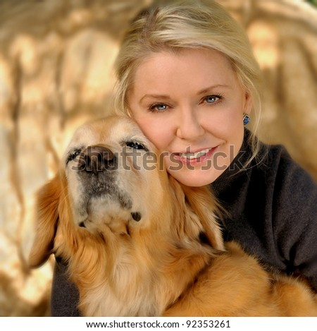 Beautiful Image of a Woman with her golden retriever - stock photo