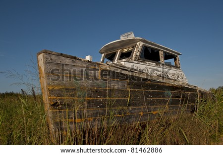 Beautiful image of an old boat deserted on Tangier Island. - stock photo