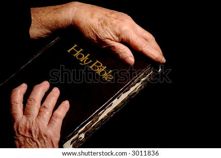 Beautiful Image of Old woman Holding Bible - stock photo