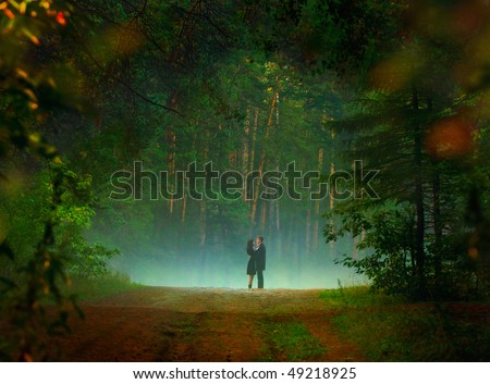 beautiful image of young couple dating in the forest - stock photo