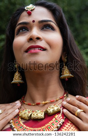 Beautiful Indian Bride in Cathedral Hallway on her wedding day - stock photo