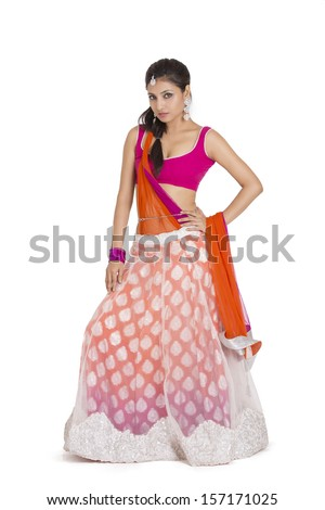 Beautiful Indian bride in colorful dress - stock photo