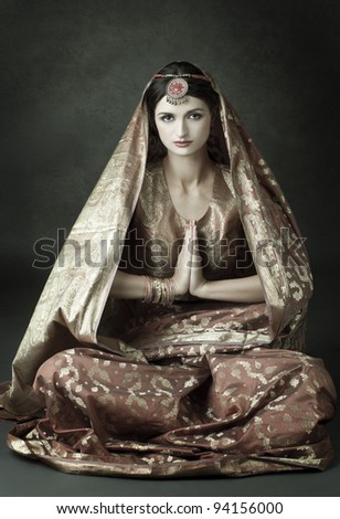 Beautiful indian brunette in traditional costume - stock photo