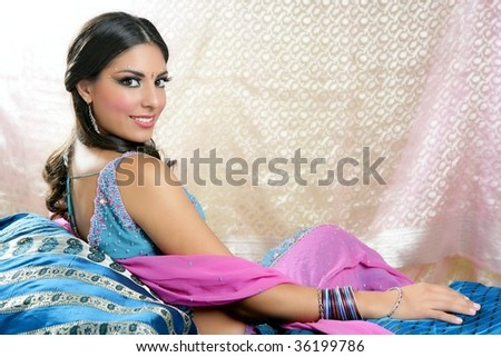 Beautiful indian brunette portrait with traditional costume - stock photo