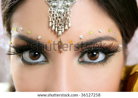Beautiful indian brunette portrait with traditionl costume - stock photo