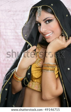 Beautiful indian brunette young woman with traditional fashion - stock photo