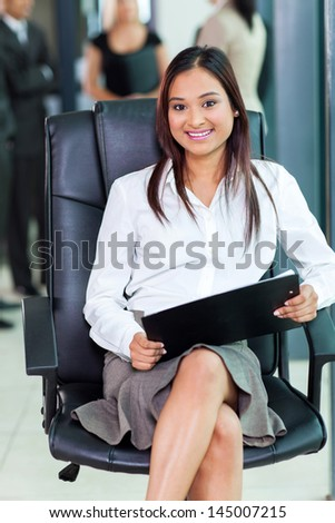 beautiful indian corporate worker sitting in office - stock photo