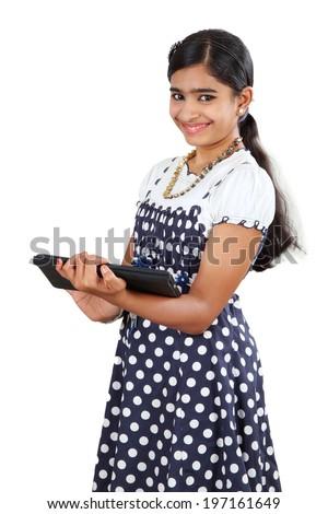Beautiful Indian female using tab, isolated on white background - stock photo