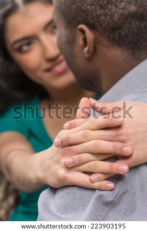 beautiful indian girl hugging her boyfriend. back view of black man looking at indian girl - stock photo