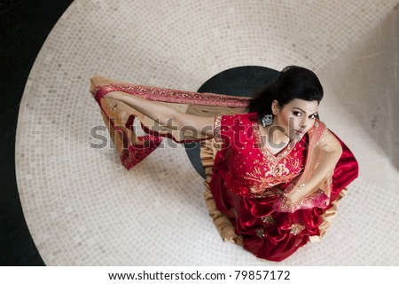 beautiful Indian girl wearing wedding gown or dress - stock photo