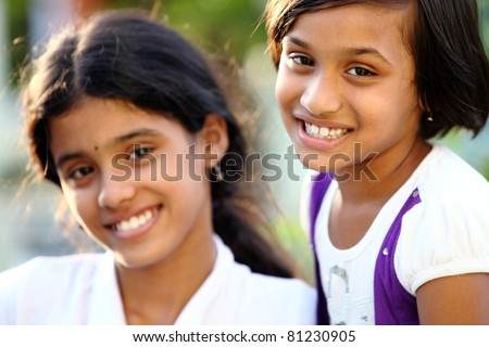 Beautiful Indian girls smiling at the camera.