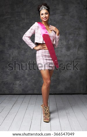 beautiful indian lady in pink skirt and jacket with shiny diadem and pink ribbon