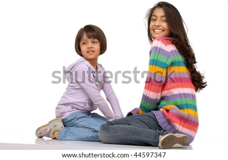 beautiful indian sisters over white background - stock photo