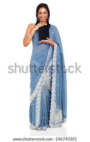 beautiful indian woman in saree showing tablet computer over white background - stock photo