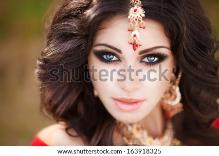 Beautiful Indian woman portrait, bright makeup woman with golden jewelry. Gorgeous Indian girl eyes. Indian beauty. Beautiful native Indian lady - stock photo