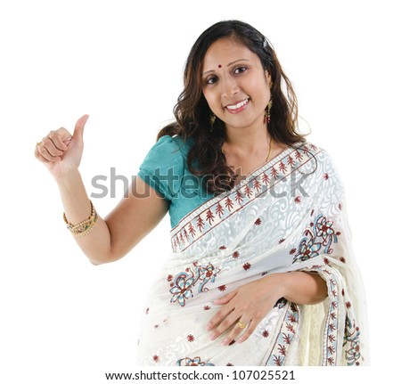 Beautiful Indian woman showing thumb up hand sign on white background