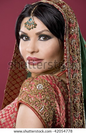 beautiful indian woman wearing bridal outfit on white