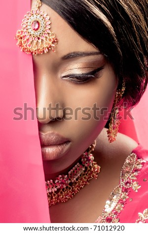Beautiful indian woman wearing traditional clothes and jewelry, closeup shot - stock photo