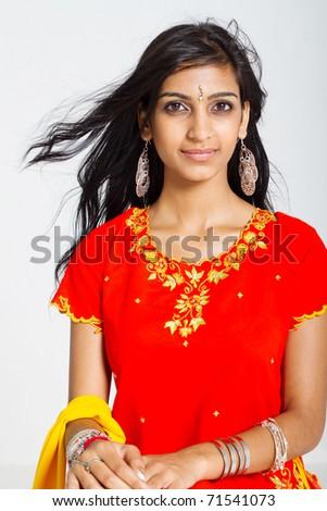 beautiful indian woman wearing traditional sari studio portrait - stock photo