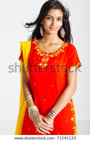 beautiful indian woman wearing traditional sari studio portrait - stock photo