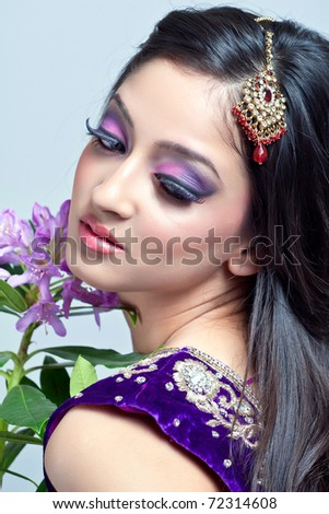 Beautiful indian woman with bridal makeup, closeup shot - stock photo