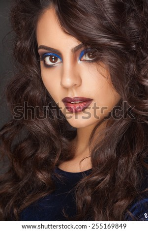 beautiful indian woman with curly hair in blue dress - stock photo