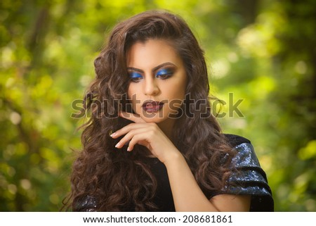 beautiful indian woman with  fashion blue make-up - stock photo