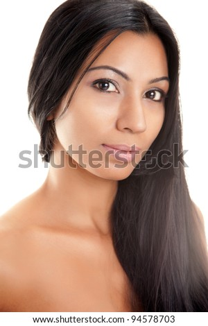 Beautiful Indian woman with long black shiny hair isolated on white - stock photo