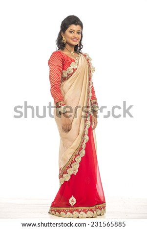 Beautiful Indian young girl in traditional saree on white. - stock photo