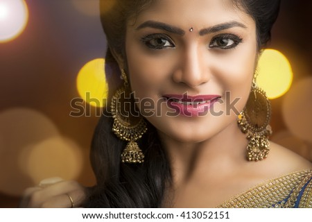 Beautiful Indian young girl portrait on grey background. - stock photo