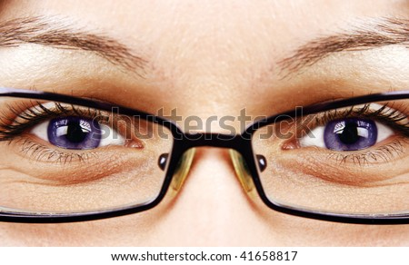 Beautiful indigo eyes and glasses - stock photo