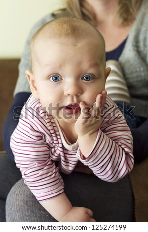 Beautiful inquisitive little baby girl - stock photo