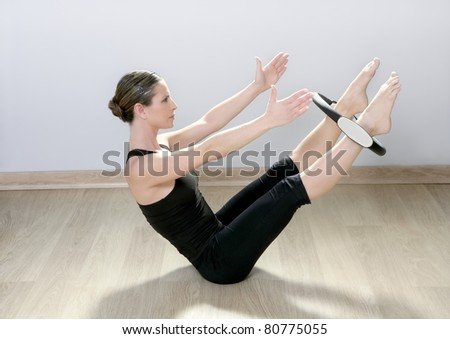 beautiful instructor woman with magic pilate ring in sport gym - stock photo