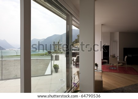 beautiful interior of a modern house, view from window - stock photo