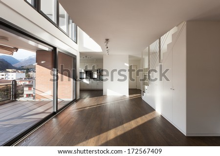 beautiful interior of a new apartment, wide empty living room