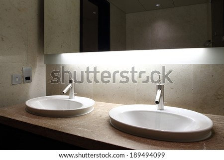 beautiful interior of modern toilet in bright colors - stock photo