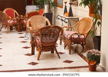 beautiful interior of the lobby: cozy wicker chairs and fresh flowers