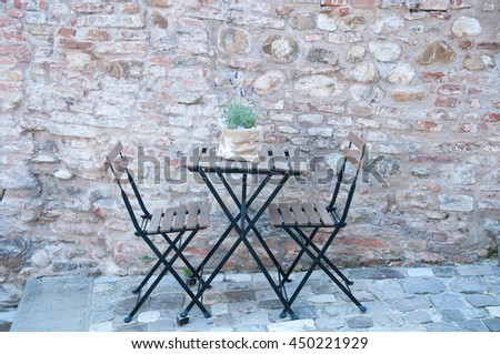 beautiful iron table for two in an ancient road