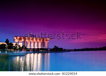 Beautiful Islamic Mosque Beside a Lake at Dusk - stock photo