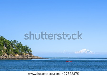 Beautiful islands in the Pacific ocean landscape. Snow-covered mountain peaks on the horizon. Canada Pacific Coast. British Columbia. Canada - stock photo
