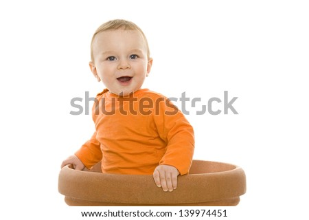 beautiful isolated baby standing in a flowerpot - stock photo