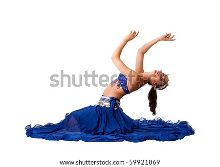Beautiful Israeli Egyptian Lebanese Middle Eastern belly dancer performer in blue skirt and bra with arms in air sitting and bending backwards, isolated. - stock photo