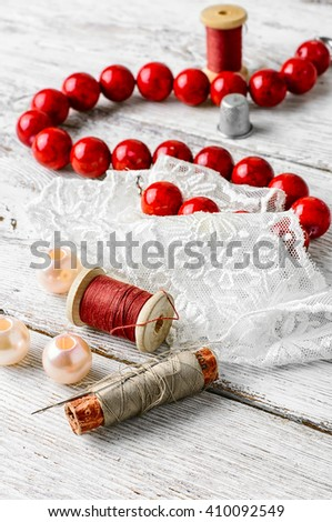 Beautiful items for needlework beads,lace and coral beads  - stock photo