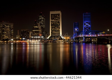 Beautiful Jacksonville, Florida skyline with reflections in St. John's River after dark - stock photo