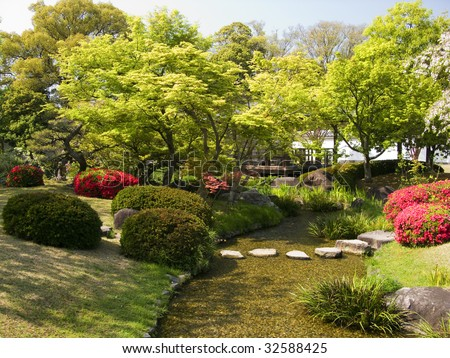 Beautiful Japanese garden with a little river - stock photo