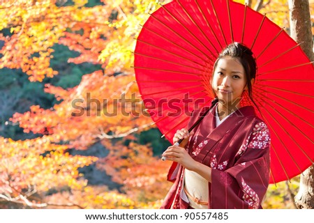 beautiful japanese kimono woman and red leaves in autumn