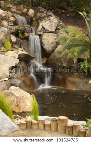 Beautiful Japanese Zen Garden Stream with Time-Lapse Slow Shutter. - stock photo