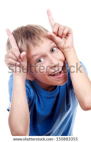 Beautiful joyful blond boy in a blue t-shirt fooling around (isolated on white background) - stock photo